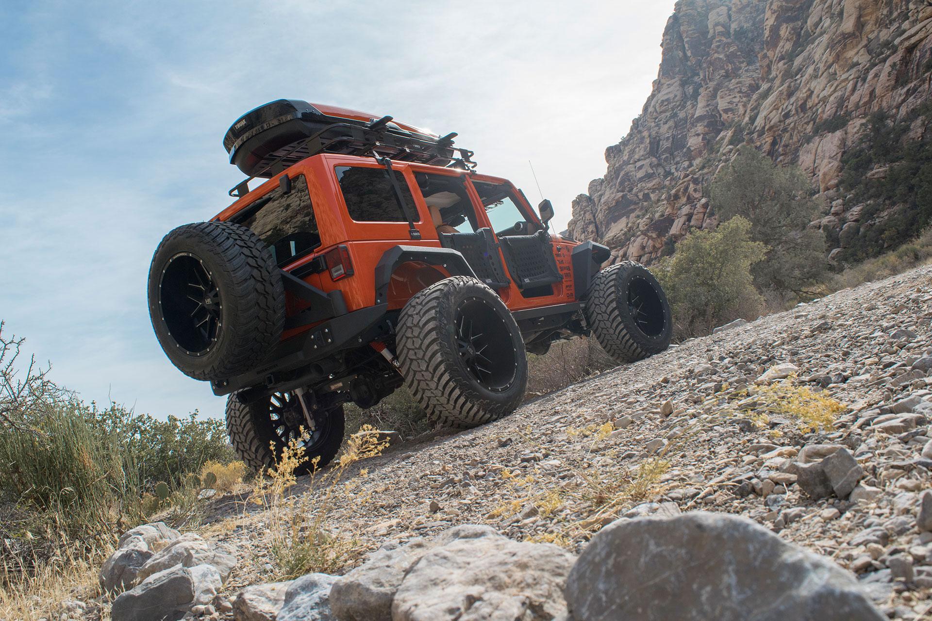 Hardrock 24x14 Affliction Wheels on an Orange Jeep Wrangler