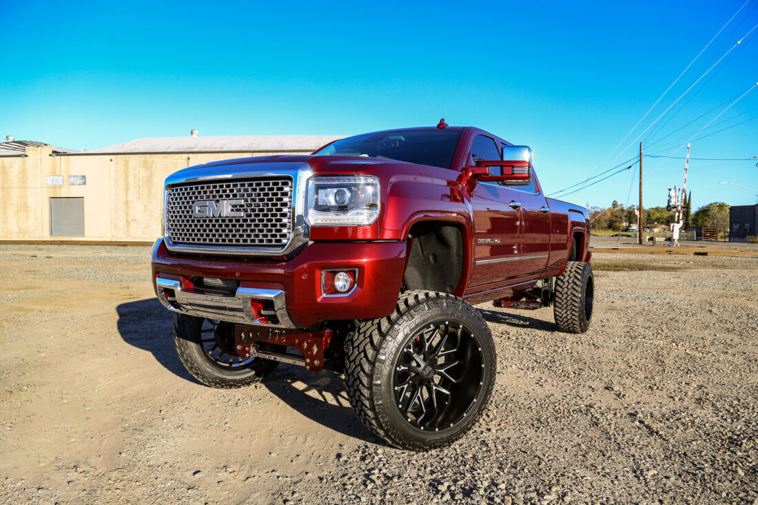 Hardrock 24x14 Affliction Wheels on a Red GMC Sierra Denali