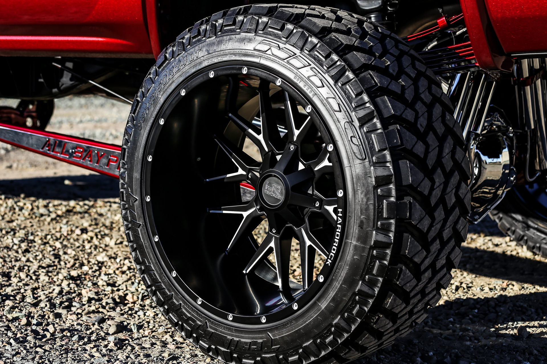 Hardrock 24x14 Affliction Wheels on a Red GMC Sierra Denali