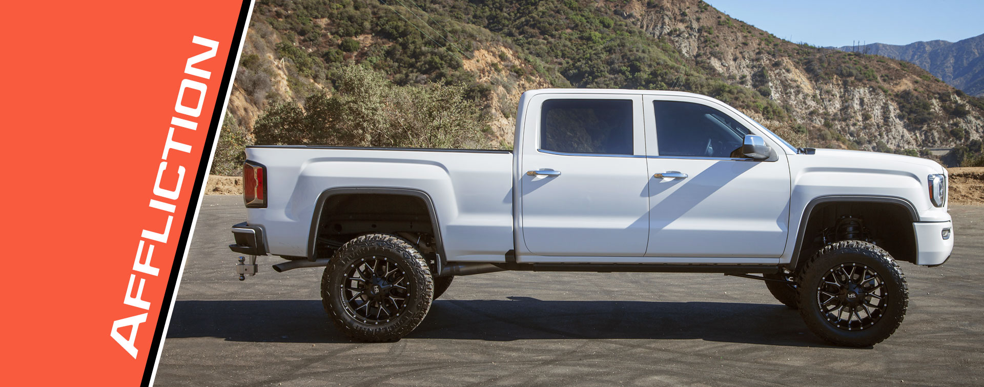 Hardrock 20x10 Affliction Wheels on a White GMC Sierra